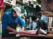 Fish being prepared at Tokyo fish market