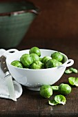 Brussels sprouts in a porcelain colander