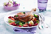 Duck leg on savoy cabbage with cranberries