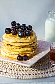 Banana and linseed pancakes with blueberries and agave syrup