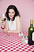 Portrait of woman in restaurant drinking wine