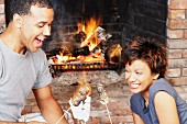 Young couple toasting marshmallows