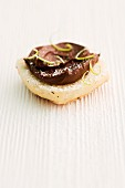 Bread roll topped with chocolate & coconut spread and lime zest