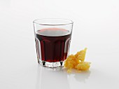 A glass of red wine against a white background