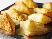 Puff pastry triangles on a baking tray (Sweden)