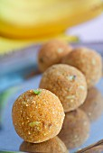 Laddu (sweets made from chickpea flour, butter, coconut and sugar)