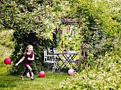 Girl at childrens party in garden