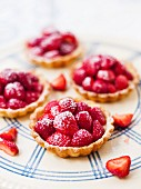 Strawberry tartlets on a plate