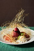Pear poached in red wine with ice cream and spun sugar