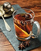 Spiced tea with lemon, cinnamon and star anise