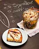 Mackerel fillets in olive oil, in a jar and on toast