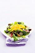 Mixed leaf salad with mango, tomatoes and radishes