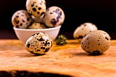 Quail's eggs in a bowl and to one side