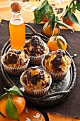 Chocolate muffins with mandarin syrup