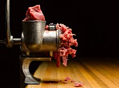Metal Meat Grinder and Wooden Table