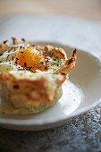 Egg in Hash Brown Nest with goat cheese, and arugula