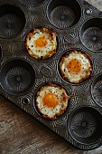 Eggs in baked hash brown nest with goat cheese and arugula filling
