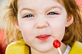 Close-up of Little Girl and Lollipop