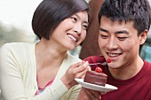 Chinese couple sharing cake