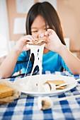 Korean girl eating smores