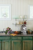 Rustic kitchen with espresso machine and storage jars