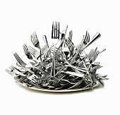 A heap of forks on a plate