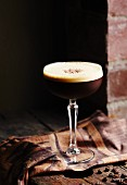 Espresso martini in a glass with a stem