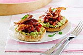 English muffins with avocado, tomatoes and prosciutto
