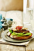 Toast with lamb steak, halloumi and red pepper relish