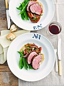 Roast lamb with mange tout and tomatoes, for two