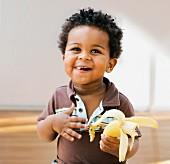 African toddler eating banana