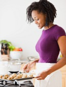 Africa woman baking cookies