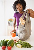 African woman unpacking groceries