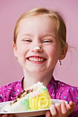 Grinning girl with birthday cake icing on her nose