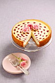 Cheesecake with raspberry sauce and rose decorations