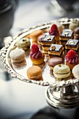 Petit fours on an elegant silver cake stand