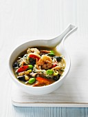 Miso soup with noodles and king prawns (Asia)