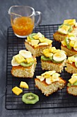 Coconut sponge cake with tropical fruits, cut into pieces