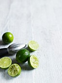 Limes, whole, halved and squeezed