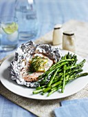 Steamed salmon with lemon and green asparagus