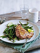 Grilled tuna steak with green beans, wasabi and sesame seeds
