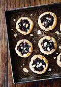 Mini berry tartlets with flaked almonds