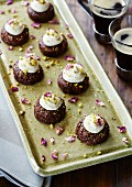 Mini plum cakes with vanilla cream and pistachios