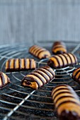 Biscuits on a wire rack, decorated with chocolate stripes