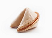 A Single Fortune Cookie on a White Background