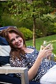 Woman Relaxing With a Glass of Wine Outdoor