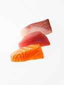 Three slices of raw tuna, salmon and yellowtail for Sashimi