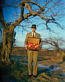 Man with Suitcase of Apples