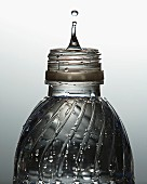 Bottle of water with drip rising from top