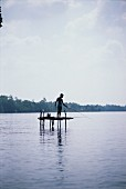 Man Fishing from Platform